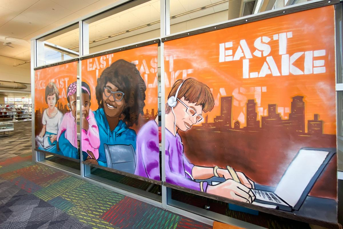 East Lake Library murals by Reggie LeFlore featuring a diverse group of people using local library